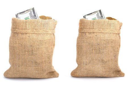 Two bags from sacking with coins and dollars isolated on white background