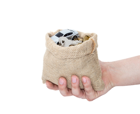 A hand hold bag from sacking with car coins and keys