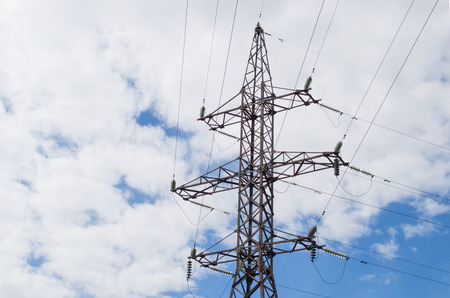 High voltage power electricity pylons on sky background