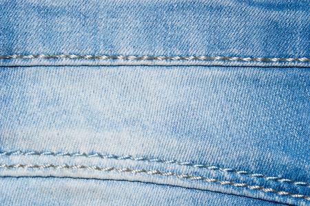 Blue jeans fabric textile close up texture background.