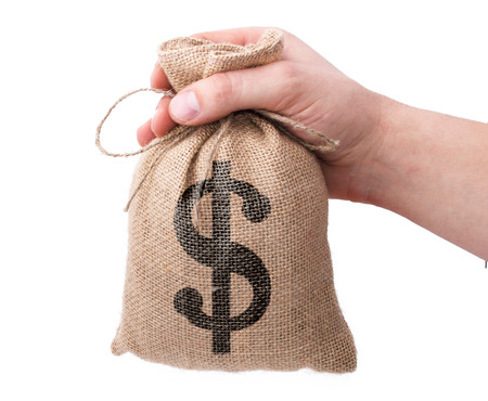 A businessman hand giving a bag from sacking with dollar sign isolated on a white background
