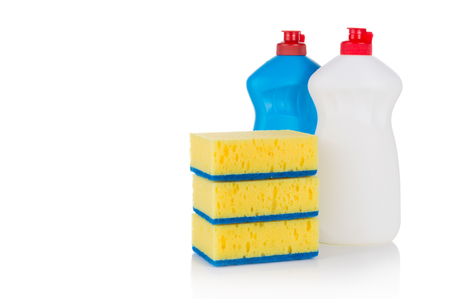 Detergent for dishes with a yellow sponges scraper isolated on white background Archivio Fotografico