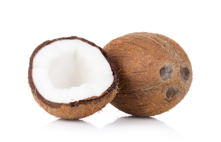sliced and whole coconut isolated on white background