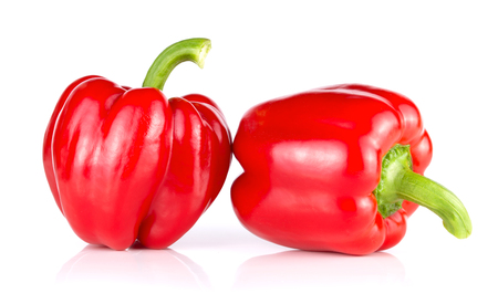 Pair of red sweet peppers isolated on white background Imagens