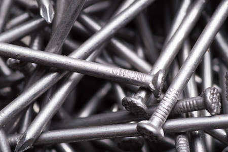 macro background of metal construction nails close up