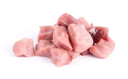 Pile of pork uncookes chopped cubes close up isolated on white background Foto de archivo