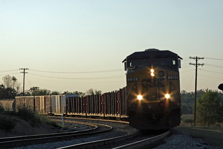 railway transportation: Train stopped on railroad tracks in the evening Stock Photo