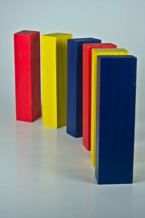 multiple colored blocks standing up in a row in a curve shape Stock Photo