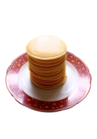 aciculum: The stack of pancakes on the plate