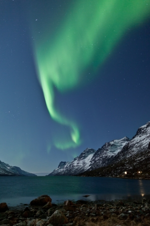 Aurora Borealis  Northern lights  reflection with fjords photo