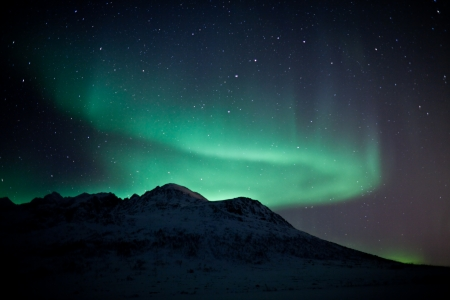 sea stars: Aurora Borealis  Northern lights  behind mountains