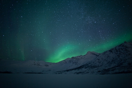 auroral: Aurora Borealis  Northern lights  behind mountains
