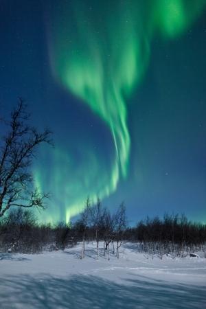 Финляндия: Aurora Borealis Северное сияние закрученной в небо Фото со стока