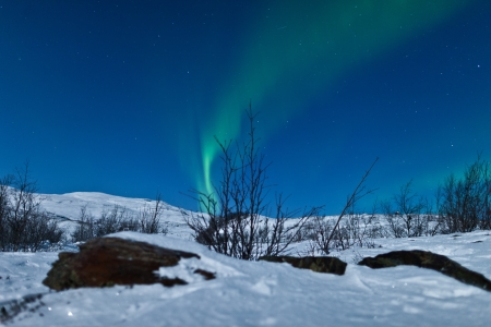 lapland: Northern Lights swirling in the night sky Stock Photo
