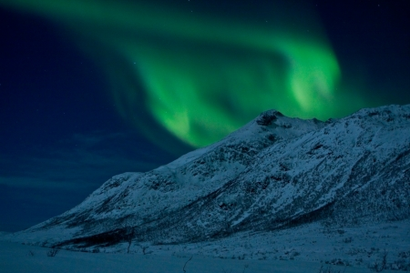 Northern Lights  Aurora Borealis  over a mountain