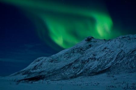 Northern Lights  Aurora Borealis  over a mountain