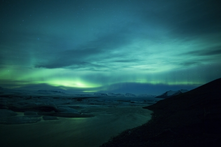 auroral: Northern lights above a lagoon in Iceland