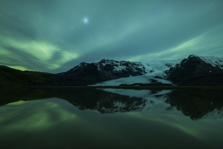 alpine zone: Northern lights above a lagoon in Iceland