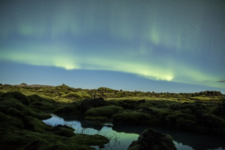 arctic zone: Northern lights above Iceland Stock Photo