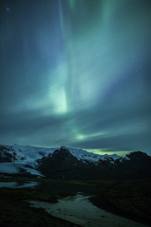 arctic zone: Northern lights above a lagoon in Iceland