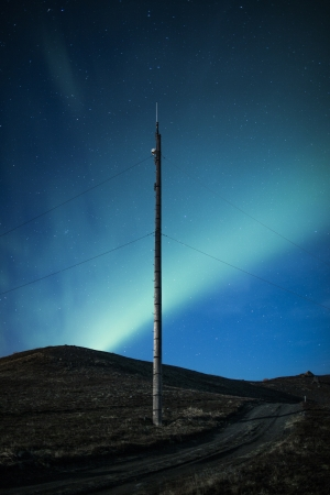 arctic zone: Northern lights above telegraph pole in Iceland