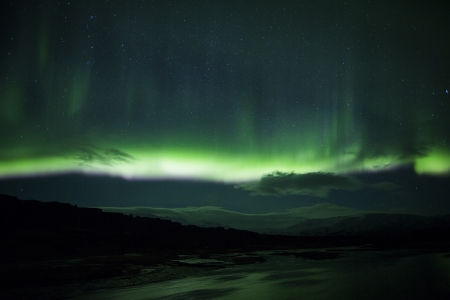 north star: Northern lights above a lagoon in Iceland