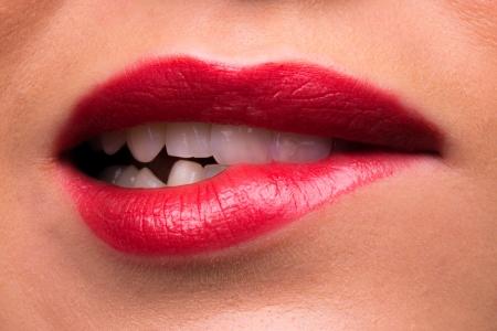 Female lips biting and teeth looking aggressive  photo