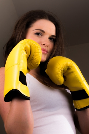 combat sport: Young sporty female with boxing gloves