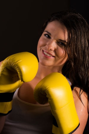 Young sporty female with boxing gloves photo