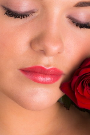 Beautiful female with romantic rose photo