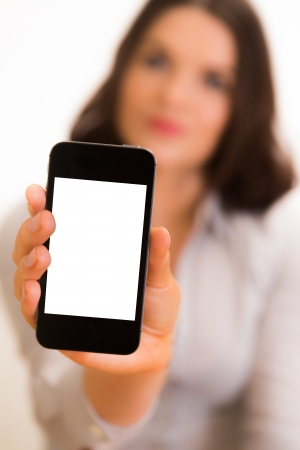 Business women posing with mobile device photo