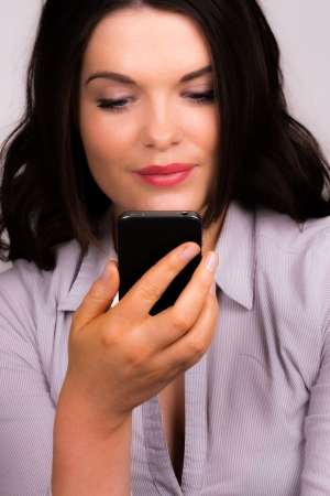Business women posing with mobile device Stock Photo - 18890722