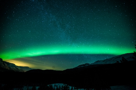 the aurora: Northern lights arc in Sweden Stock Photo