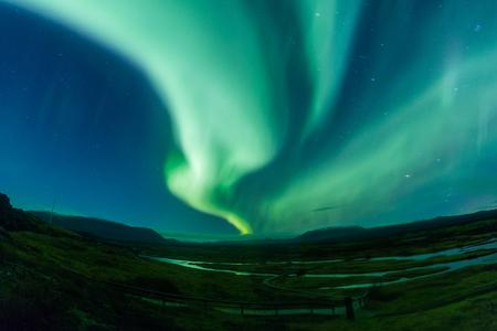 Aurora borealis (Northern Lights) in Island Standard-Bild - 52697711