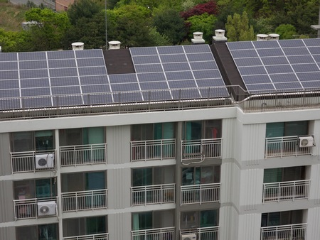 Apartment roof with solar panels Stock Photo