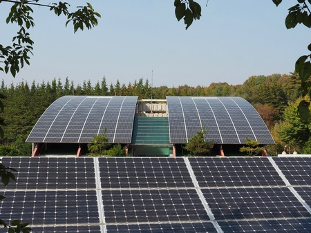 voltaic: Parking lot with solar panel in Korea and building roof Stock Photo