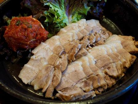 Korean food Kimchi and pork, Napa Wraps with Pork, Bossam Stock Photo