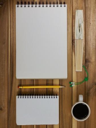 Sketchbook and pencil, coffee, fan, notepad Archivio Fotografico