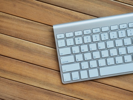 Wooden board with white keyboard