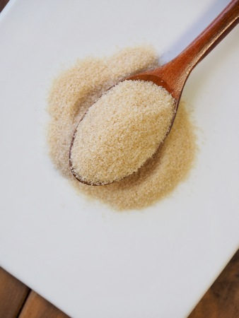 Brown powdered sugar in a spoon