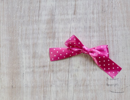 White background with pink ribbon