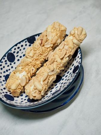 Korean food rice peanuts stick taffy