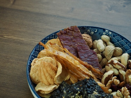 Dried food Beef jerky and laver crackers and dried filefish and Brazil nuts and Almonds, walnuts, cashew nuts