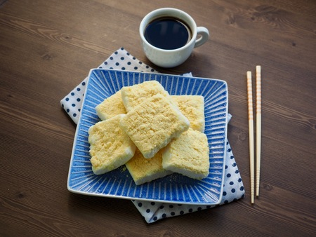 Korean traditional food yellow steamed rice cake and coffee