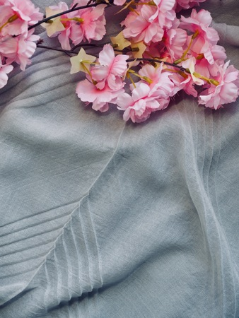 cherry blossoms and cotton fabric background