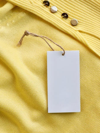 Yellow spring sweater and clothing label