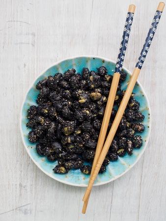 Black bean and black sesame stir-fried snack and chopsticks