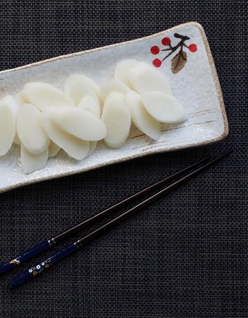 Korean food, Bar rice cake and folding fan Archivio Fotografico