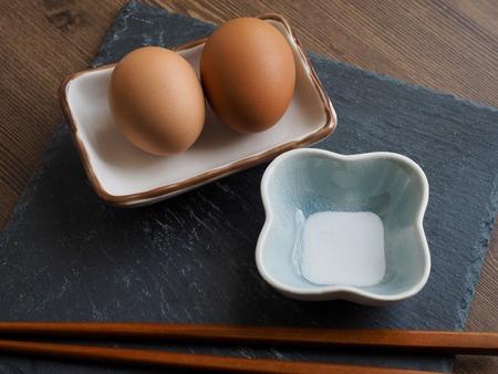 Steamed eggs and salt and chopsticks