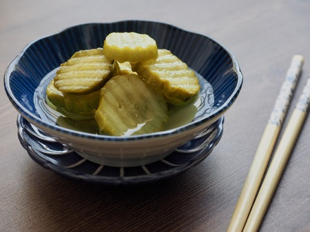 side dish Cucumber pickle and chopsticks Banco de Imagens